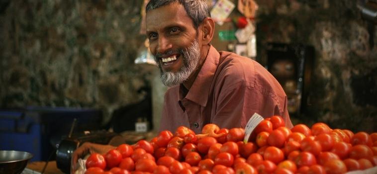 De Reünie Met De Lachende Mauritiaanse Marktman